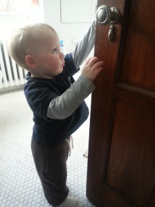 Testing out the doorknobs.