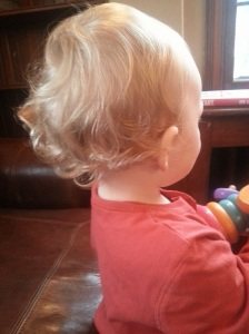 Curls!! I cannot bring myself to cut them off yet. And John has persuaded himself that it counts as a mullet.