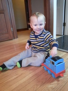 Loves him some Thomas, mainly because the episodes are short, the trains make noise, and the theme song is good.