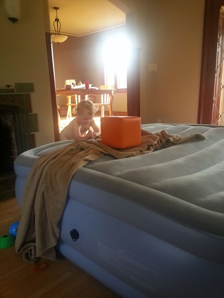 We're going to have to get him his own air mattress. I think it may be cheaper than a kid-friendly trampoline anyway!