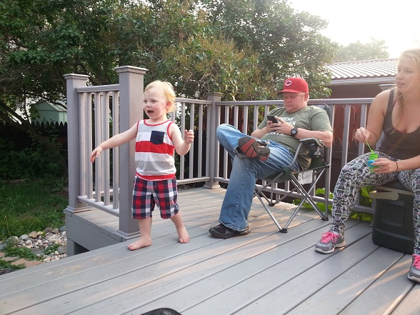 Yelling at Grandpa. Or possibly at Auntie M's bubbles. (Also, check out #Beardless back there!)